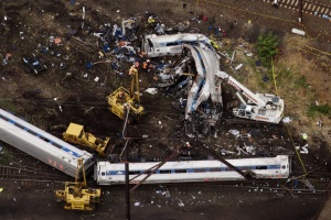 Emergency workers look through the remains of a derailed Amtrak train in Philadelphia, Pennsylvania May 13, 2015.  Rescue workers on Wednesday sifted through twisted metal and debris from the wreck of the Amtrak train that derailed in Philadelphia, killing six people and injuring scores of others, as investigators began reviewing data to determine the cause of an accident. REUTERS/Lucas Jackson       TPX IMAGES OF THE DAY