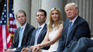 Donald Trump, right, sits with, from left, Eric Trump, Donald Trump Jr., and Ivanka Trump during a ground breaking ceremony for the Trump International Hotel on the site of the Old Post Office, on Wednesday, July 23, 2014, in Washington. (AP Photo)
