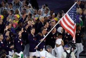 Michael Phelps carries the flag